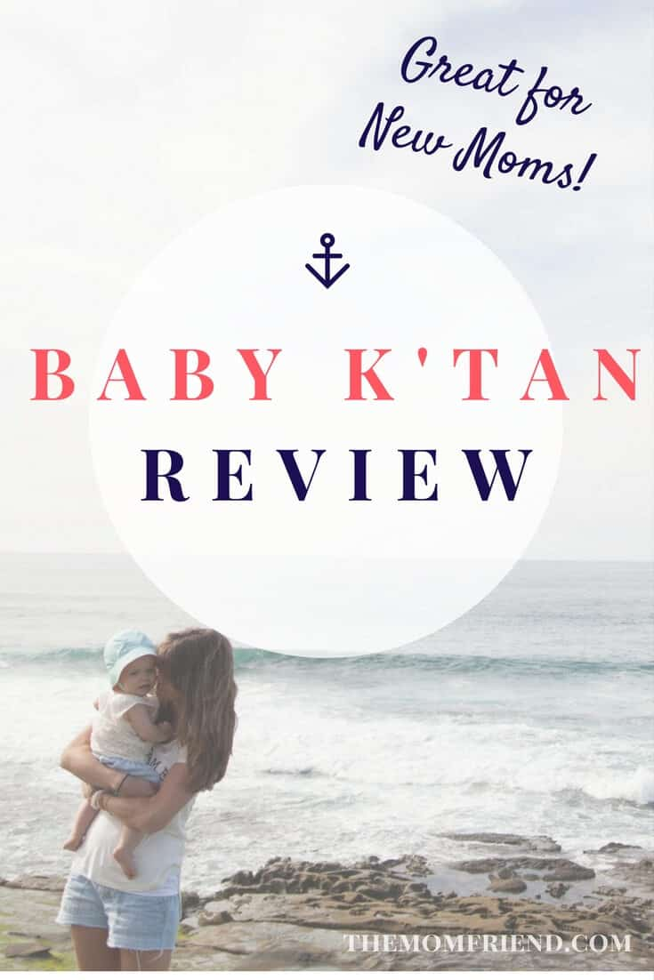 Pinterest graphic with text for Baby K-Tan Review and image of mother holding baby next to ocean.