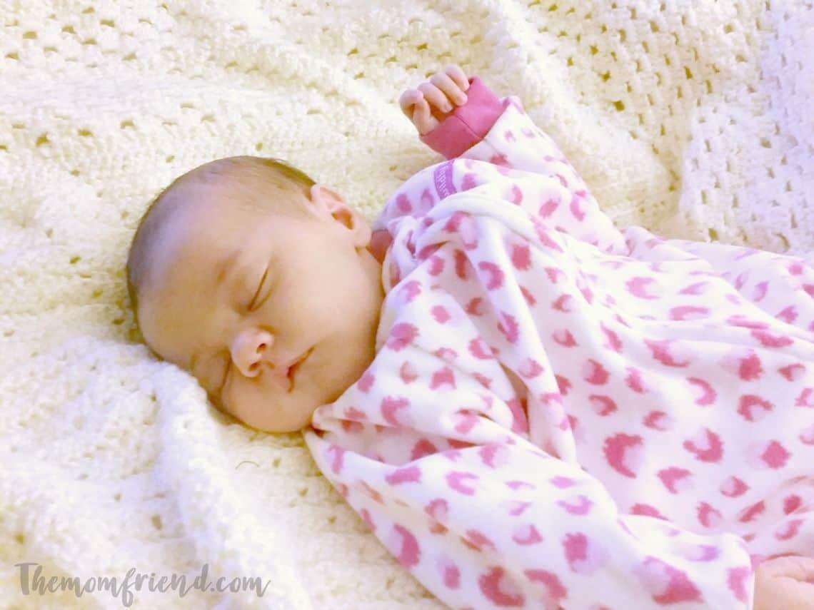 Baby girl sleeps in fuzzy pajamas.