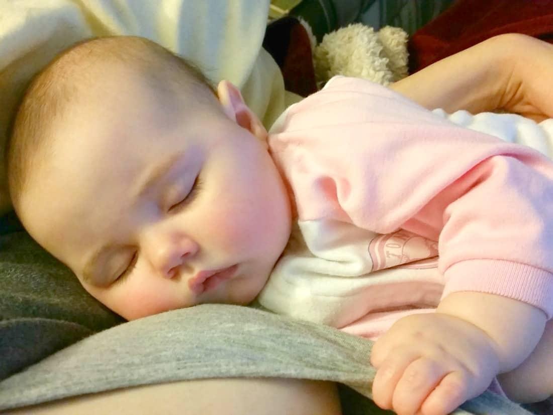 Sleeping baby after nursing.