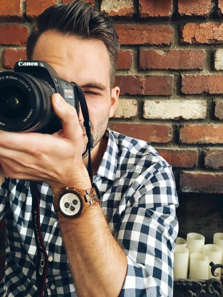 Man holds camera to take shot.