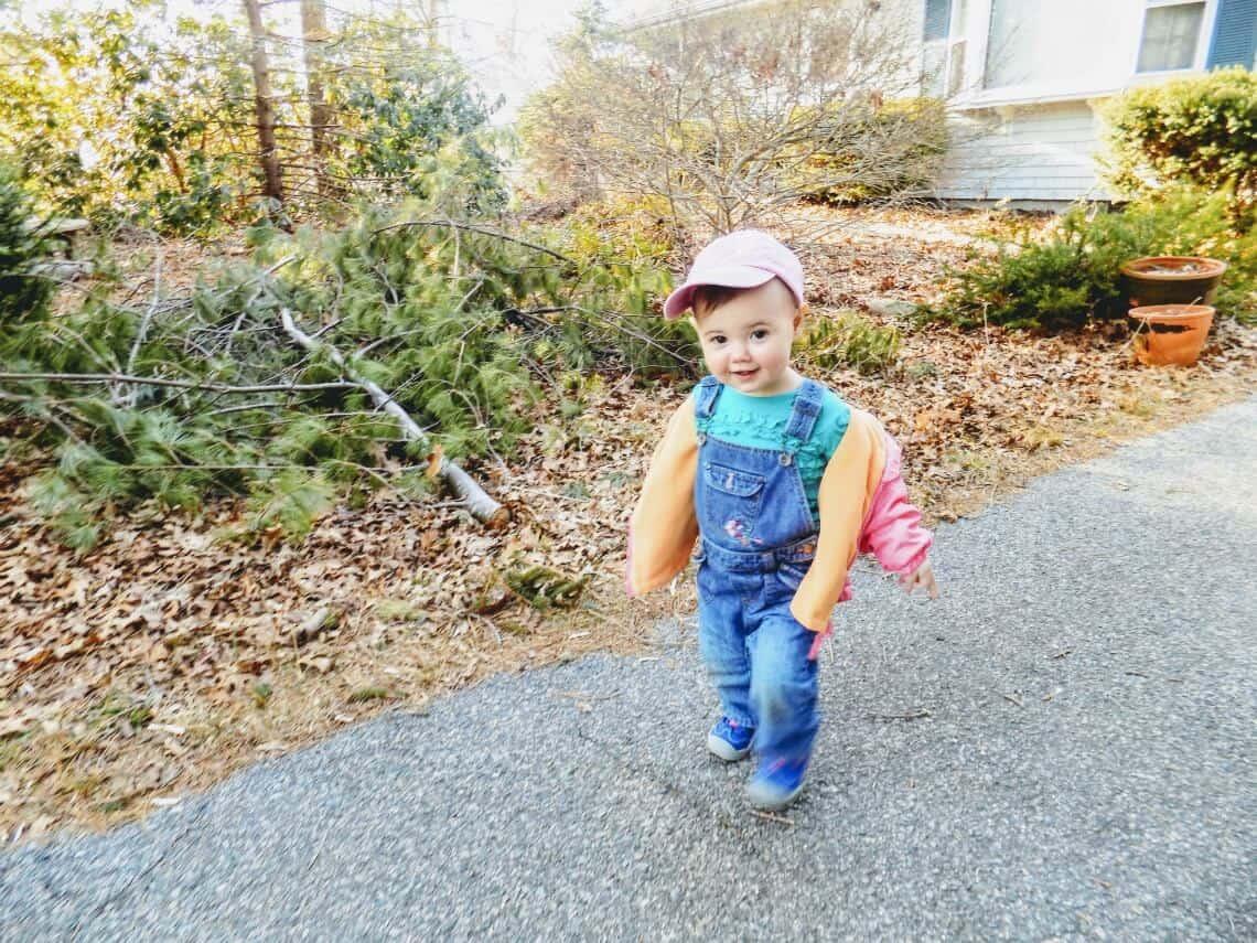 Little girl walks outside during spring.