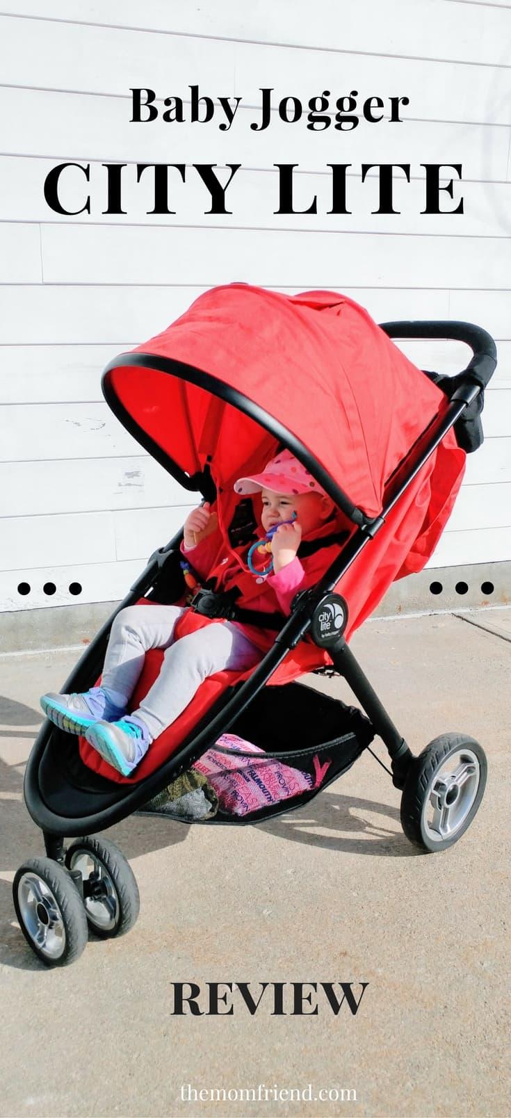 Toddler girl in red jogging stroller.