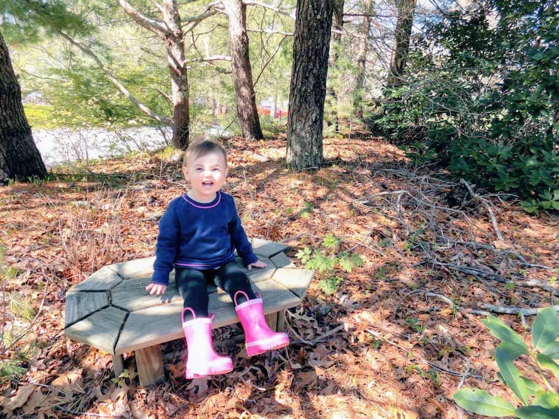 Toddler girl stays safe from ticks in woods.