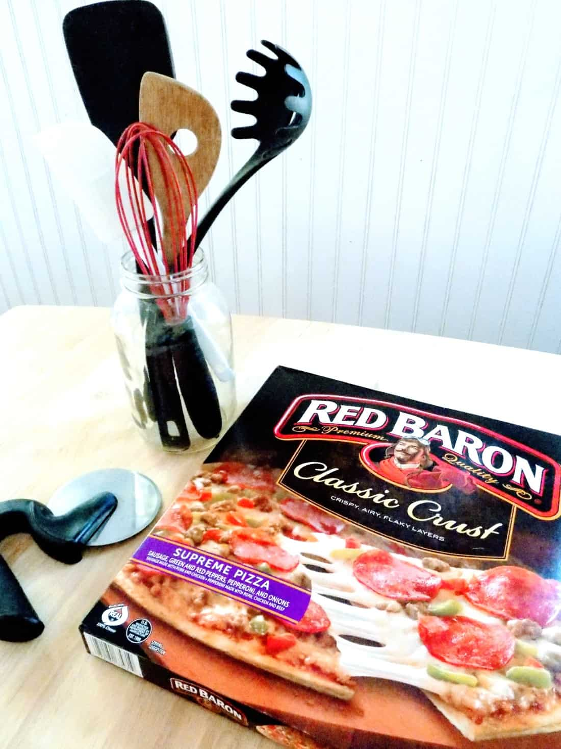 Box of Red Baron pizza on counter.