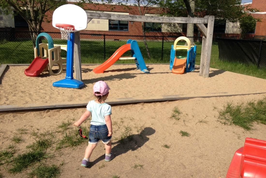 Little girl plays at playground.