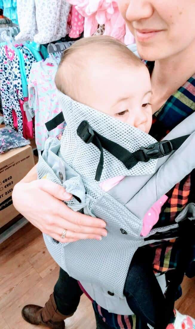 Baby looks out over top of baby carrier.