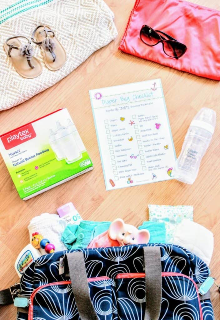 Diaper bag and checklist for summer day out with baby.