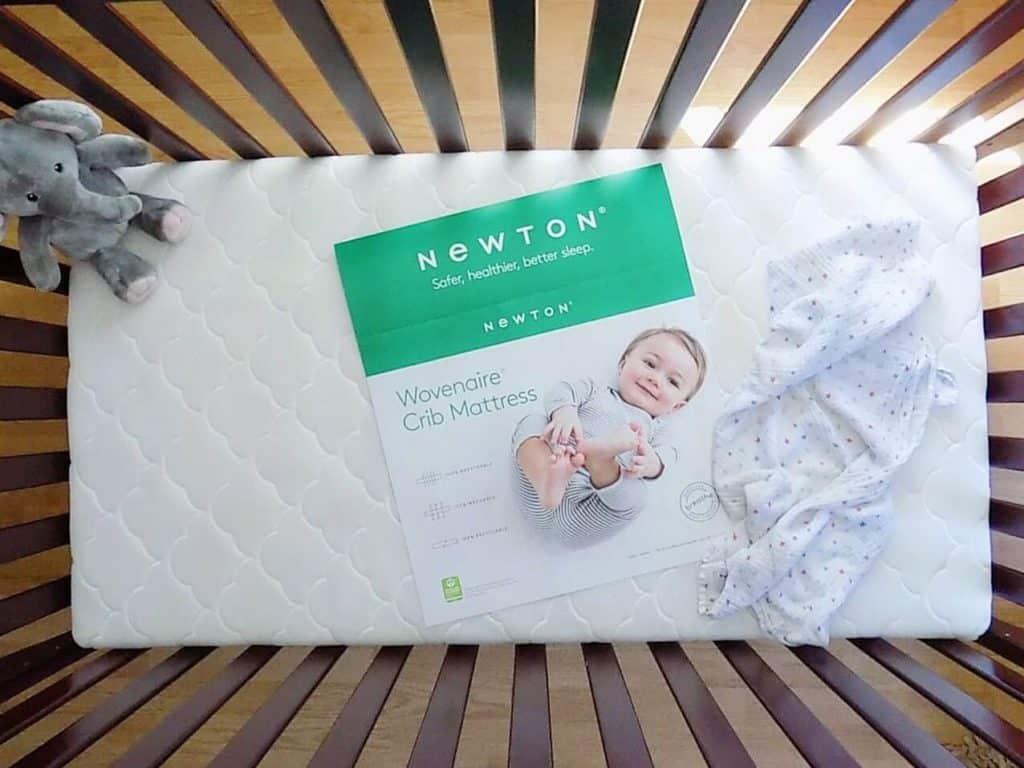 Newtown crib mattress product info insert in crib.