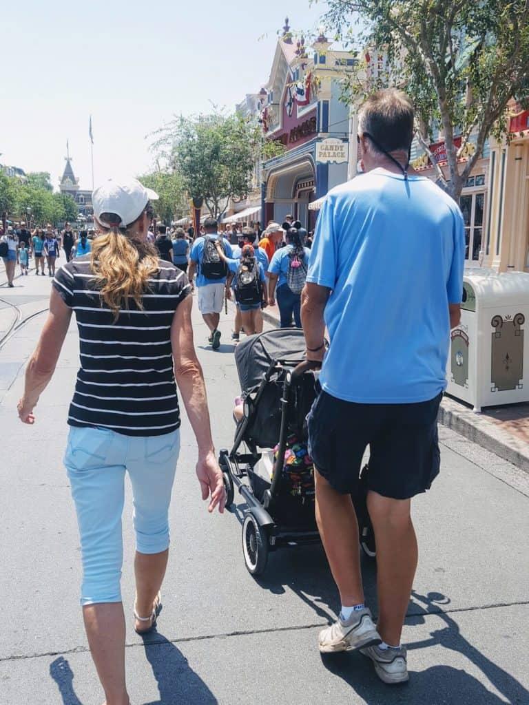 Family walks down streets of Disney World.