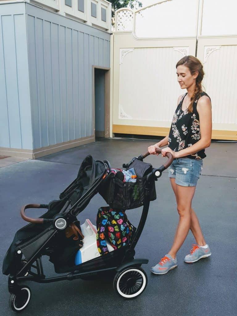 Woman pushes stroller at Disney.