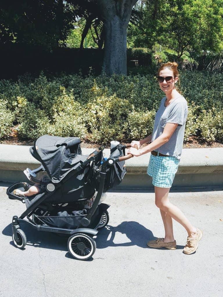 Mom pushes Austlen stroller down Disney street.