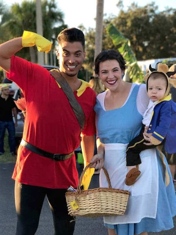 Family wears Beauty and the Beast costume for Halloween.