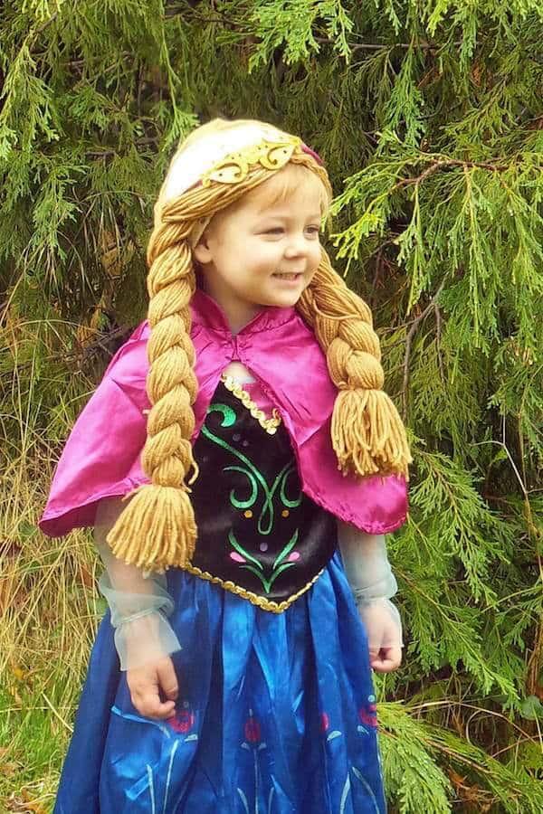 Girl wears frozen costume for Halloween.