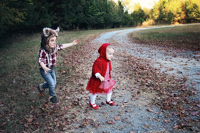 Girl and boy wear Little Red Riding Hood sibling costume for Halloween.