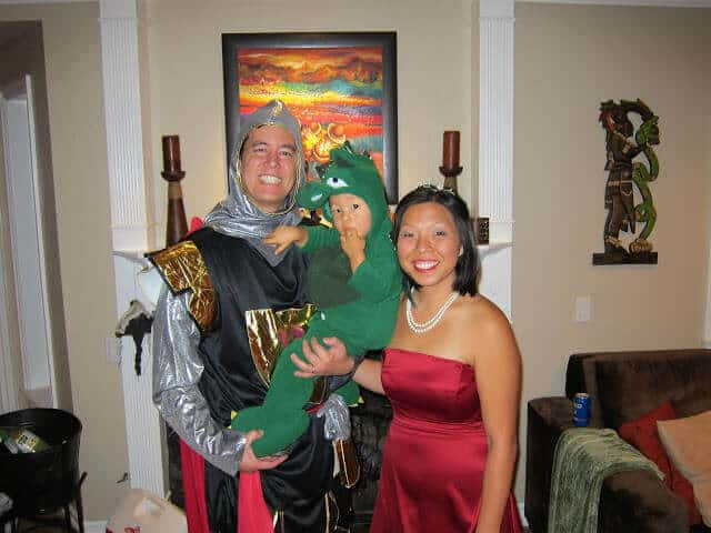Family wears Knight and Dragon costumes for Halloween.