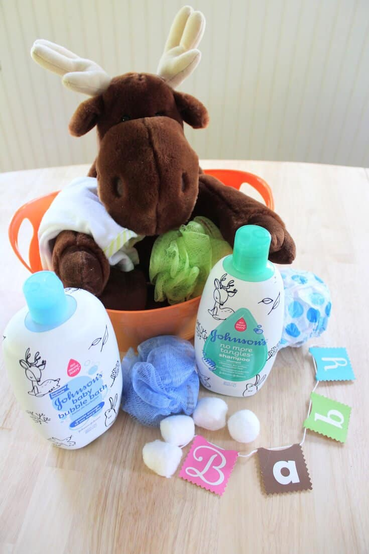 Moose stuffed animal and skin care products for babies.
