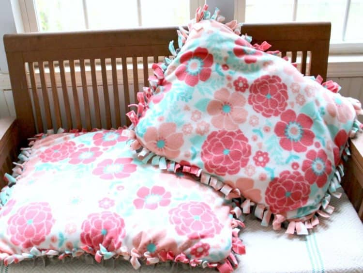 Pillows sit on table.