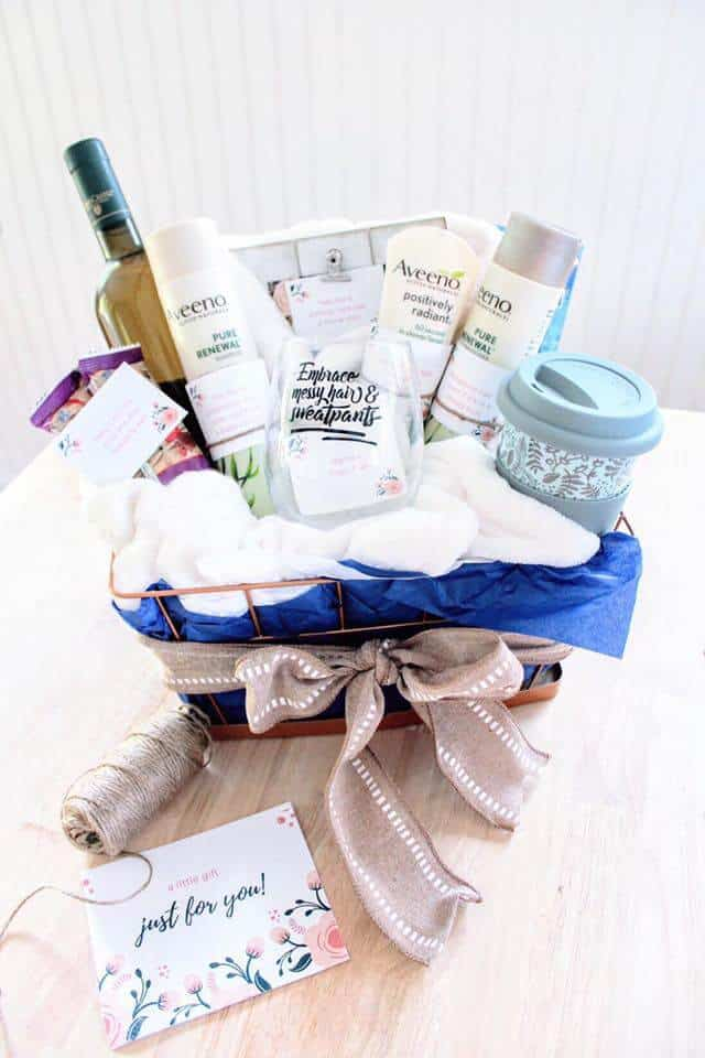 new mom gift basket filled with postpartum and self care items with printable gift tags