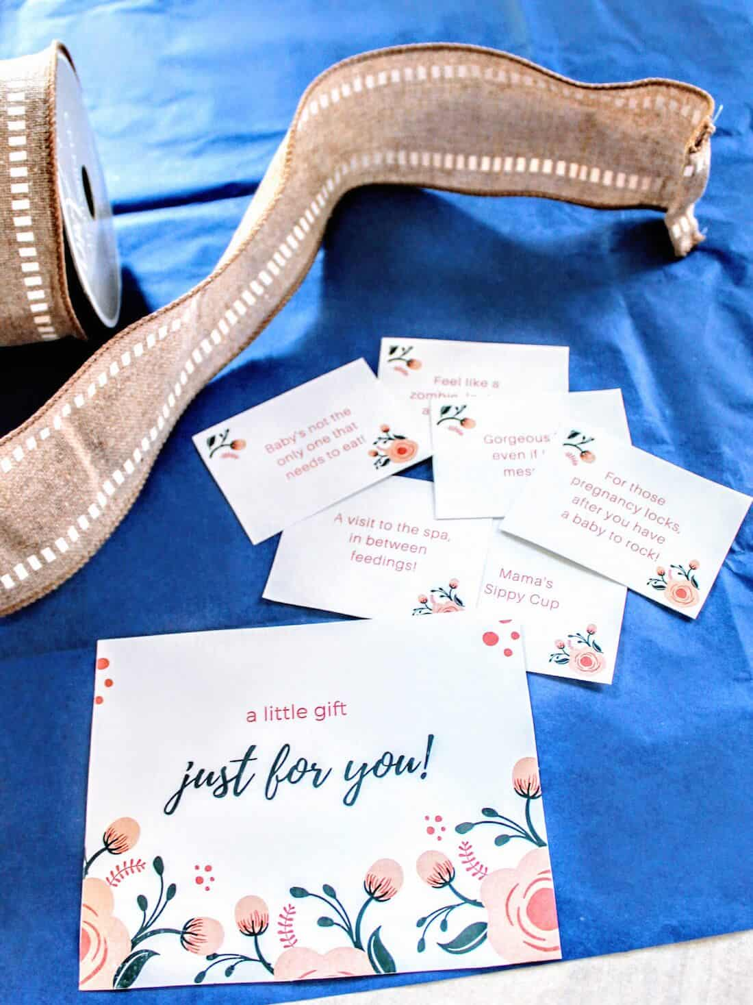 Gift cards next to ribbon.