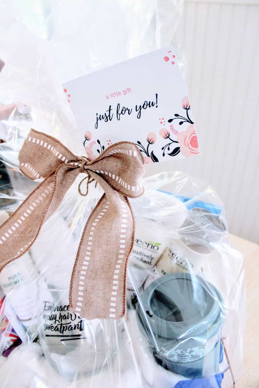 Gift basket with card and ribbon on top.