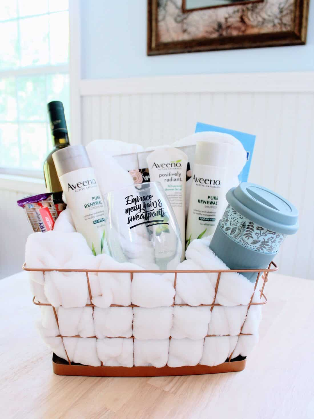 Gift basket filled with comforting items for new moms.