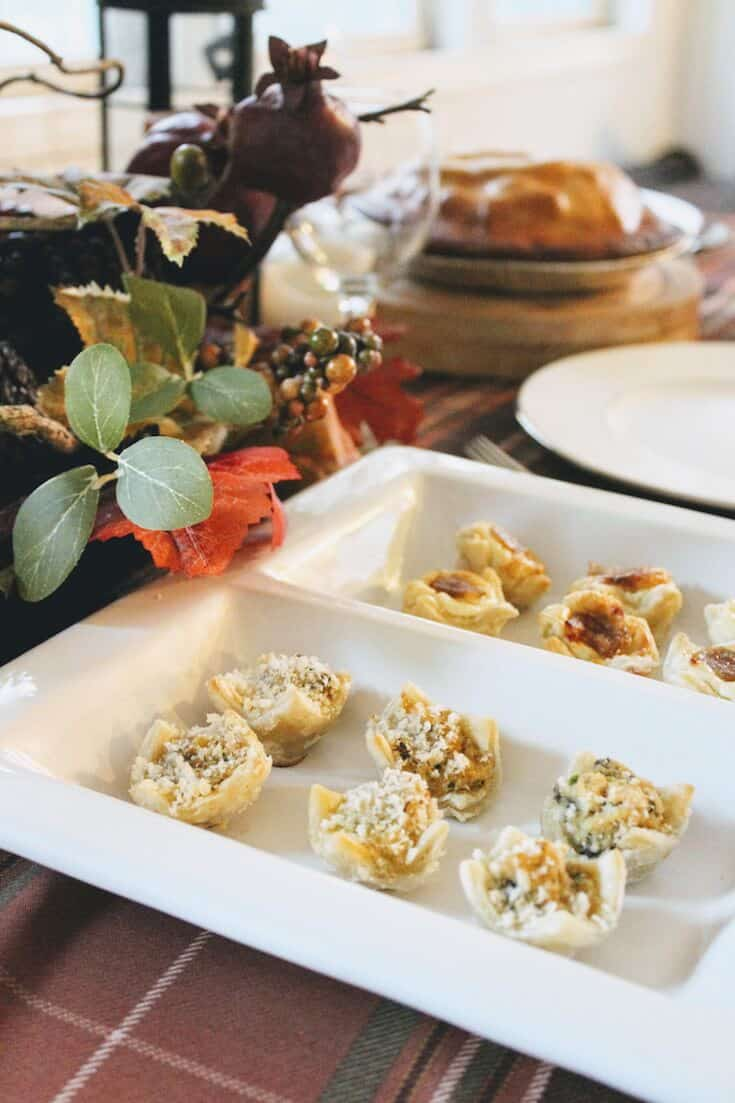 Thanksgiving appetizers on decorated table.