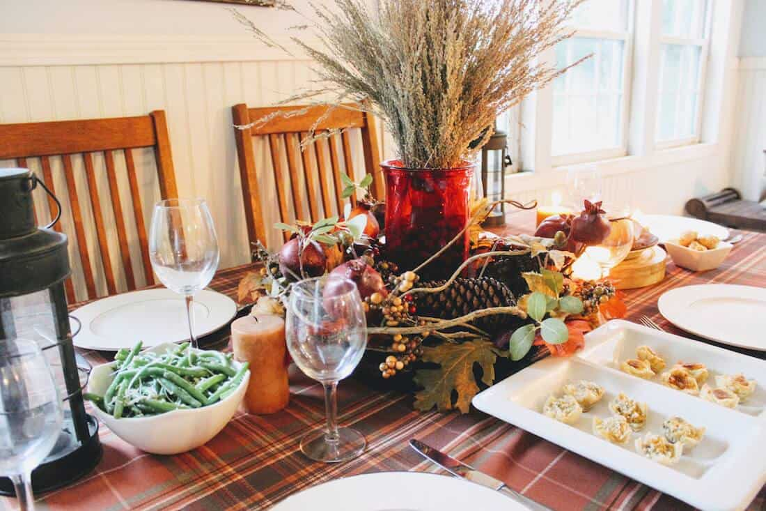 Table decor for Thanksgiving and food.