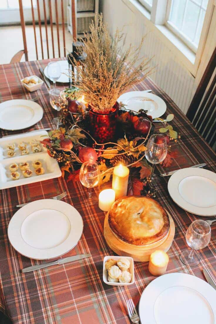 Thanksgiving dinner table with candles.