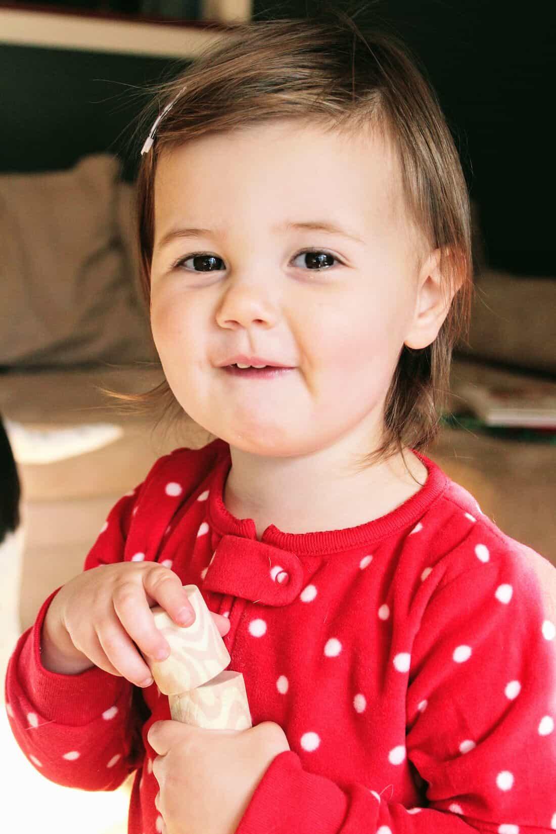 Toddler girl in Christmas PJs.