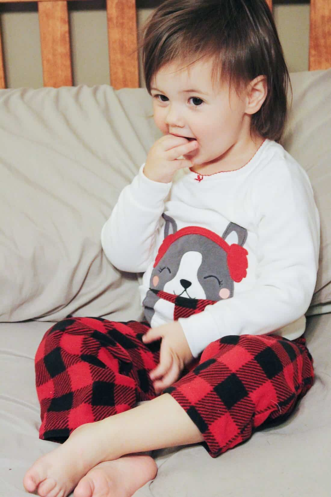 Toddler girl in two piece Holiday pajama set.