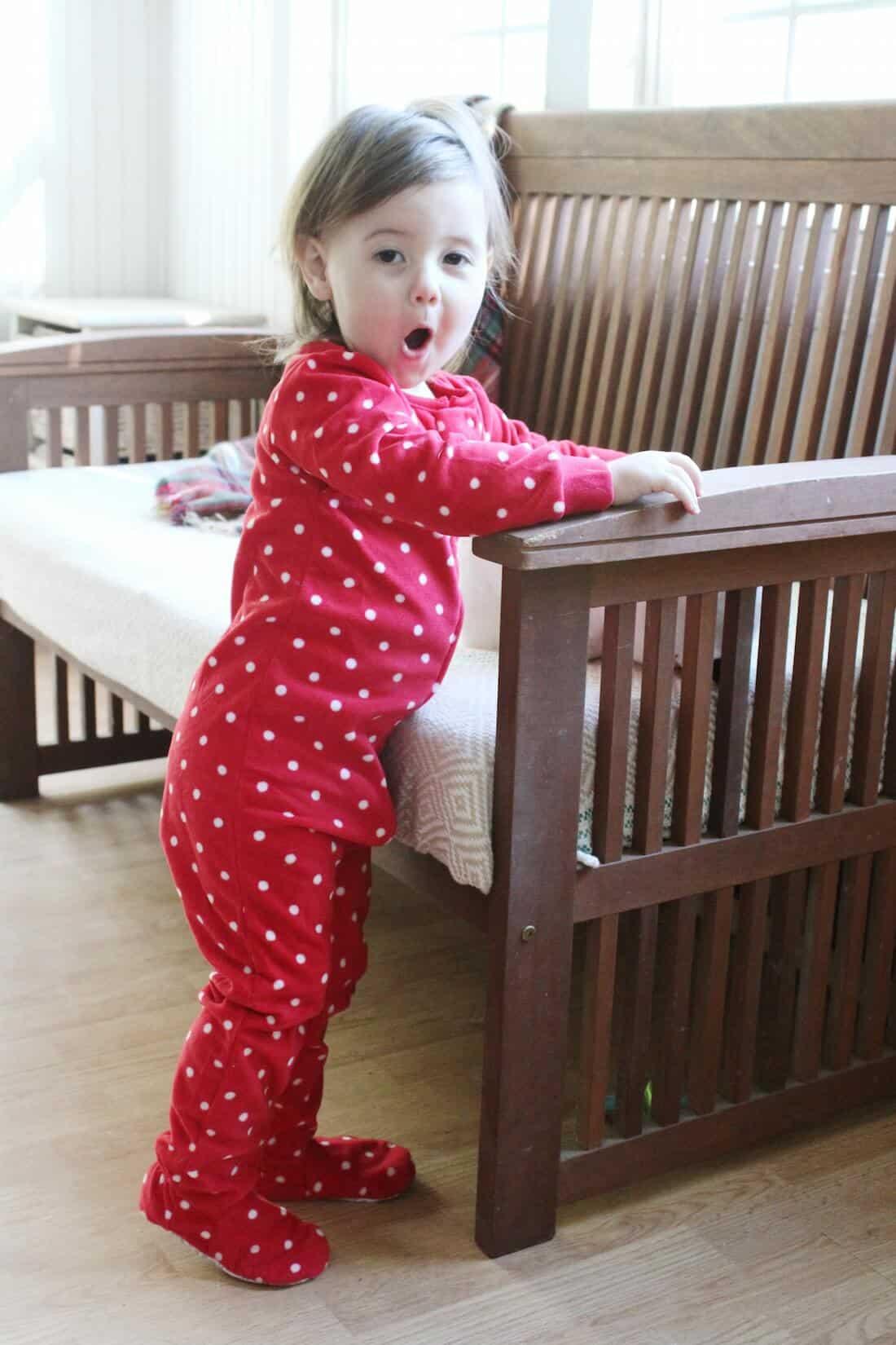 Toddler girl on Christmas morning.