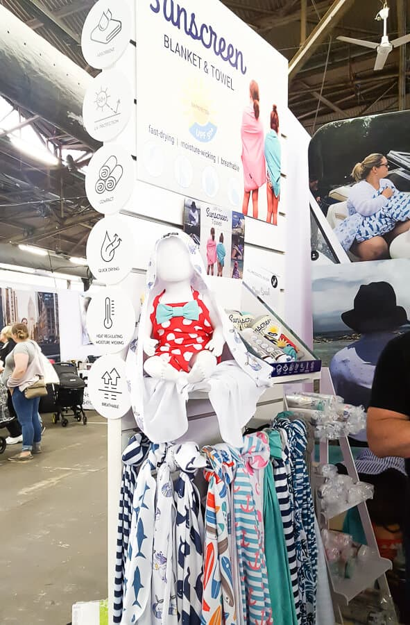 Baby clothes on display at show.