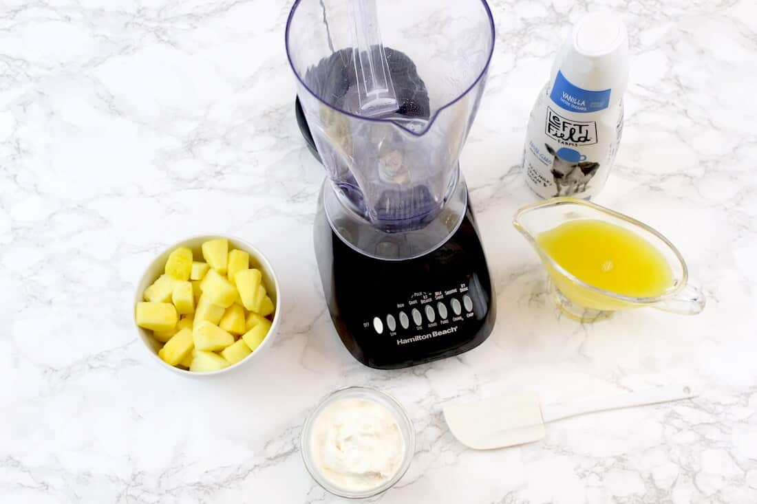 Blender and smoothie ingredients.