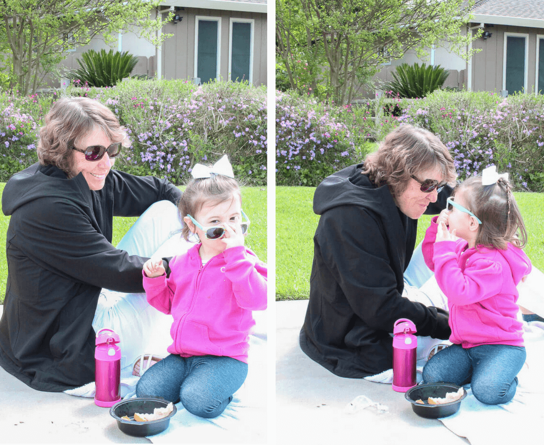 Woman eats outside with grandaughter.