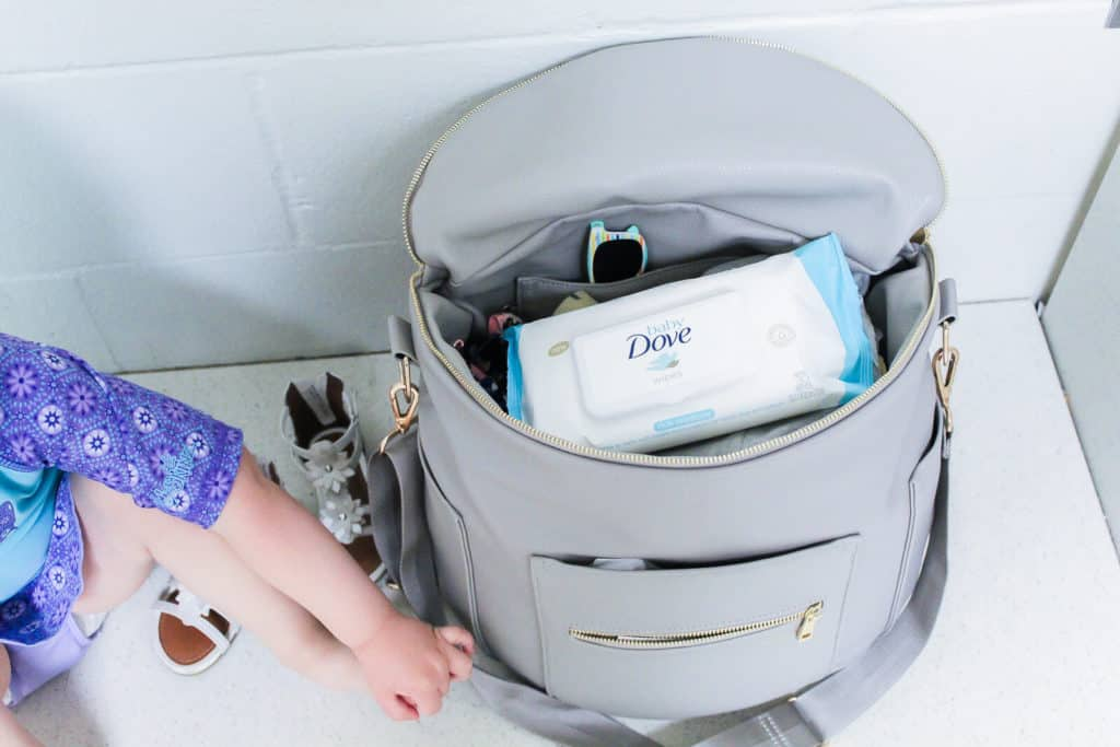 Diaper bag with Dove brand wipes inside.
