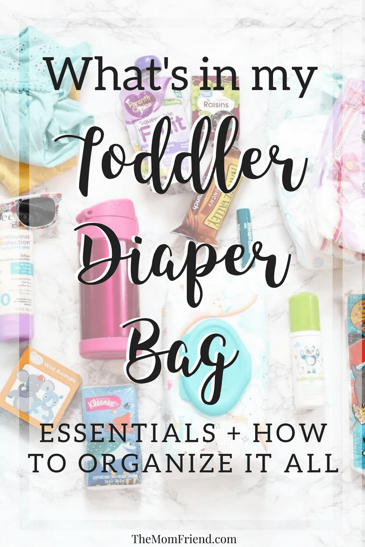 Pinterest graphic with text and image of diaper bag items.