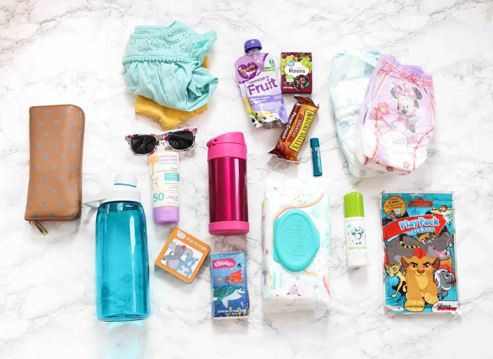Check out what's in my toddler diaper bag including all the essentials and how to organize it, and even use your own purse with the ToteSavvy instead of a baby diaper bag!