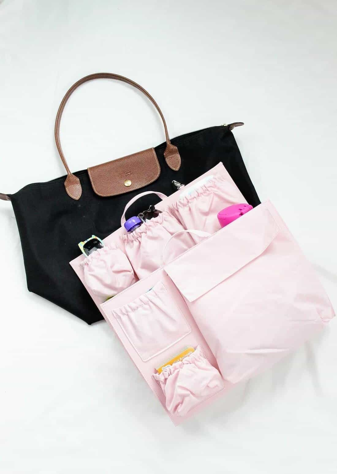 Pink insert for diaper bag for toddlers.