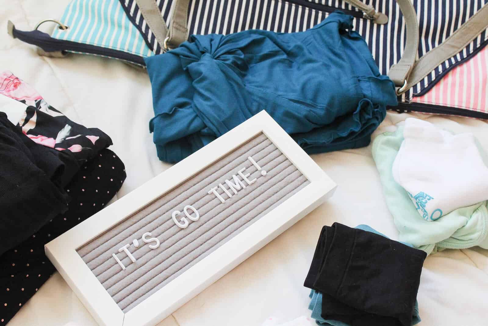 ""\""""It's go time"""" letter board next clothes and bag for hospital.""1600|1067|?|en|2|b2a3c09aeae085f11f5e56b4ec86a1d8|False|UNLIKELY|0.28162989020347595