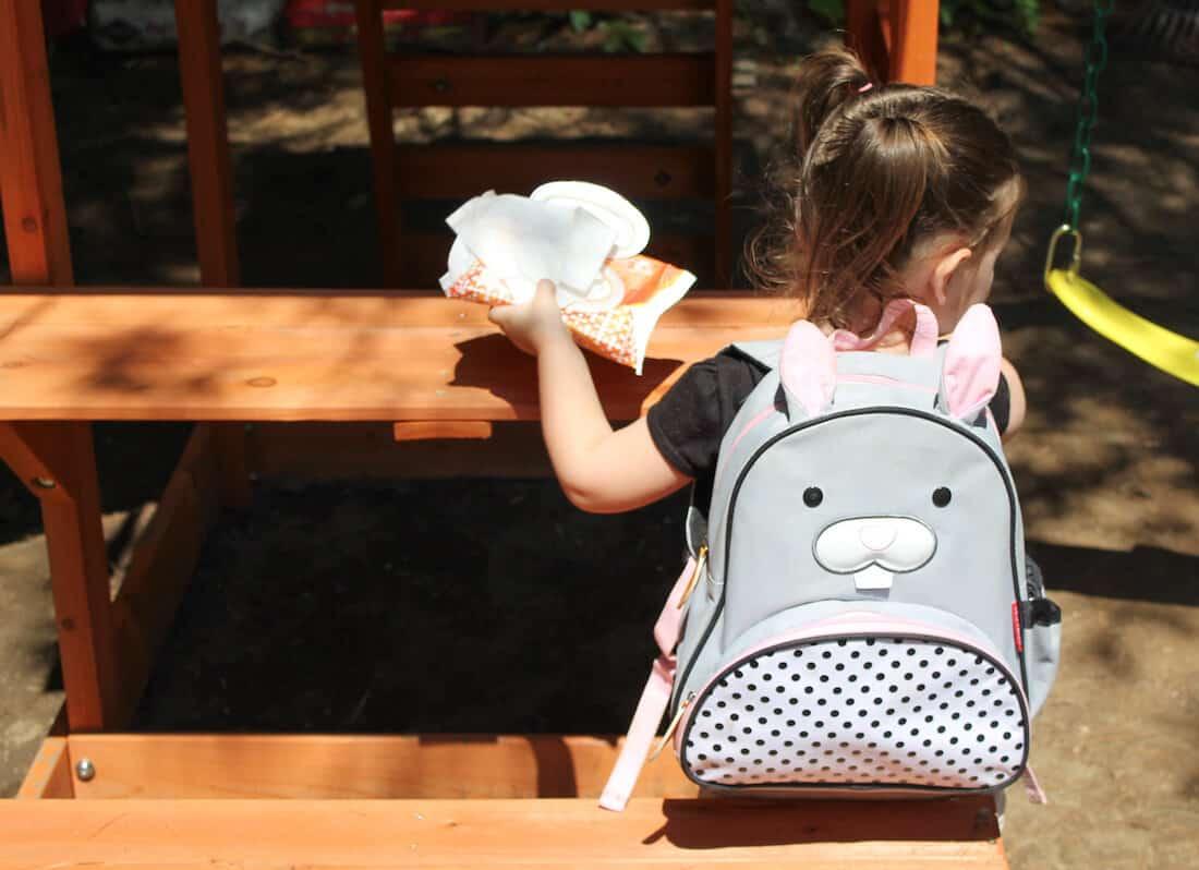 Girl wears bunny backpack for preschool.