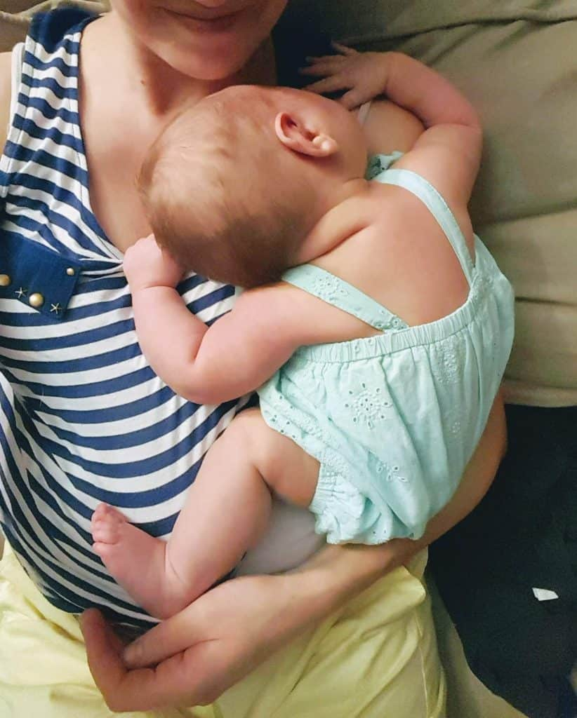 Mother holds newborn baby.