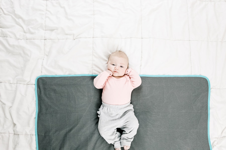 baby on a swaddle blanket