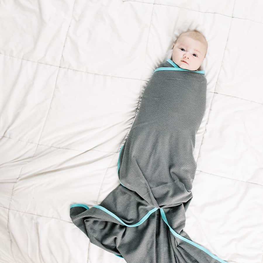 Image in step by step tutorial to swaddle a baby.