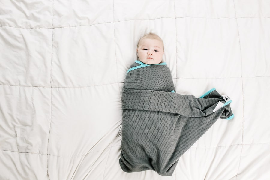 final step of doing a boat swaddle: tuck in the last corner