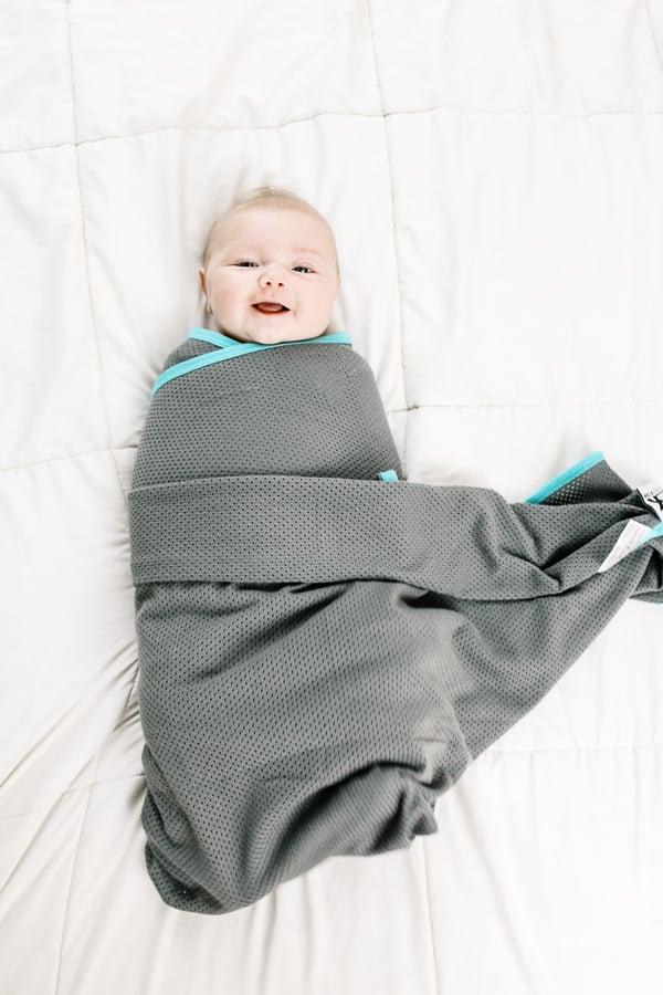 smiling swaddled baby