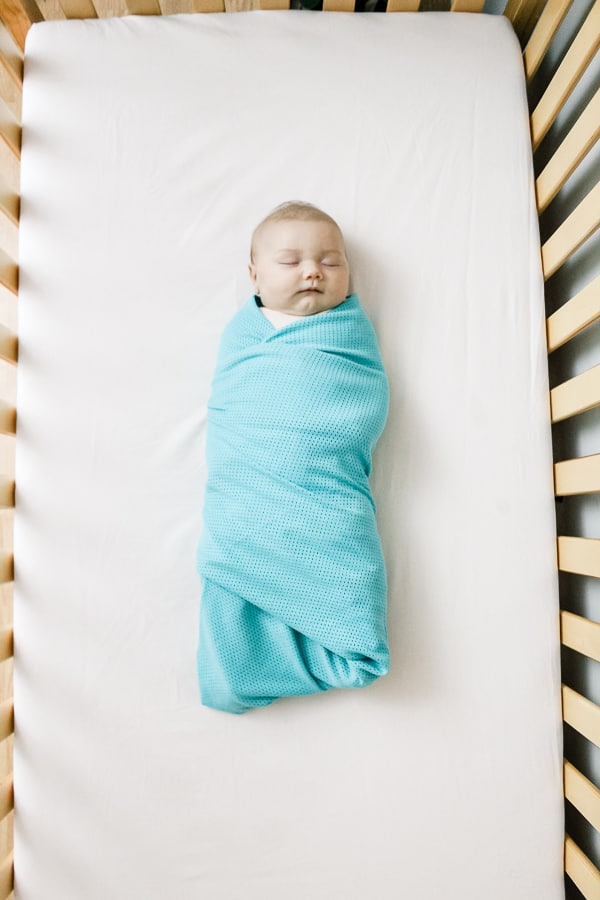 swaddled baby sleeping peacefully