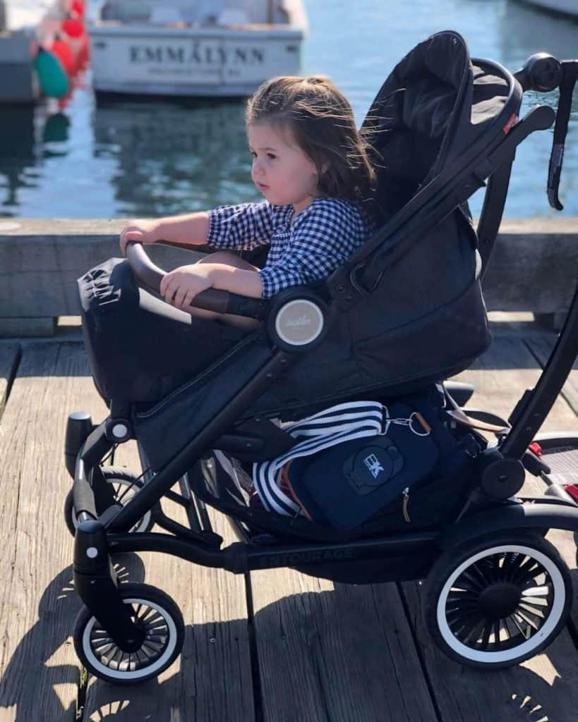 Baby in stroller on dock in Massachusetts.
