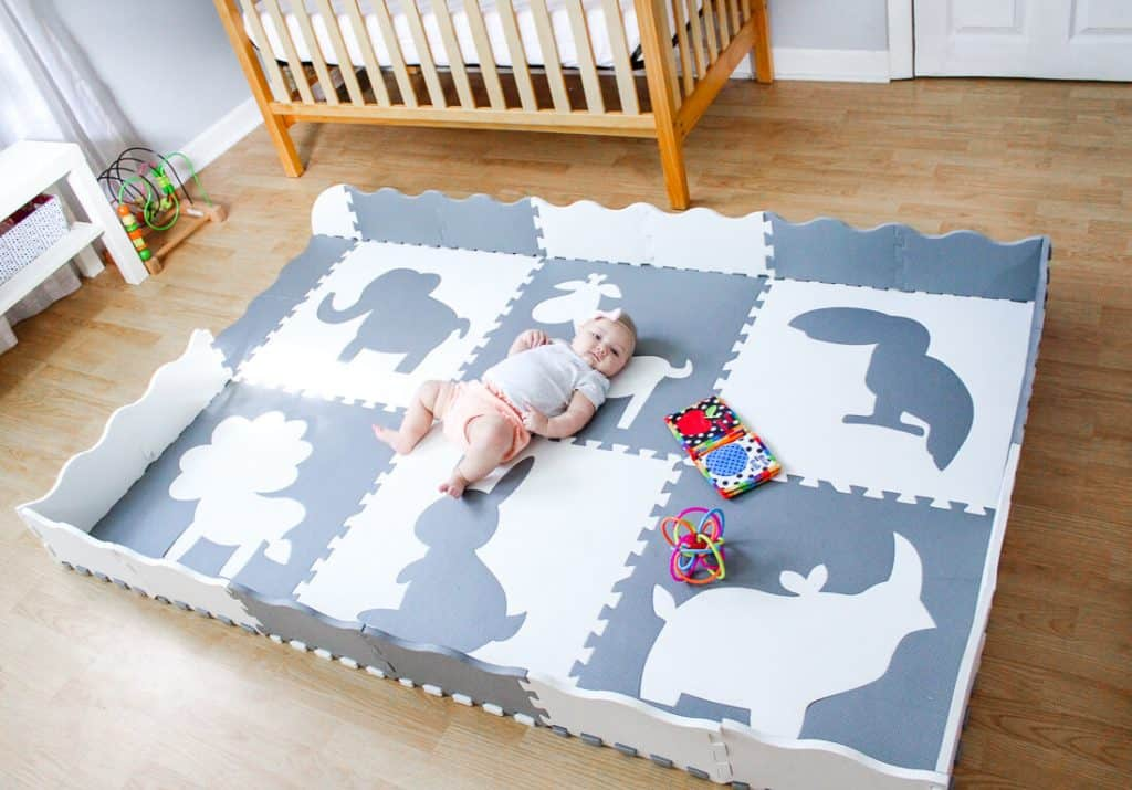 newborn baby on foam play mat tiles