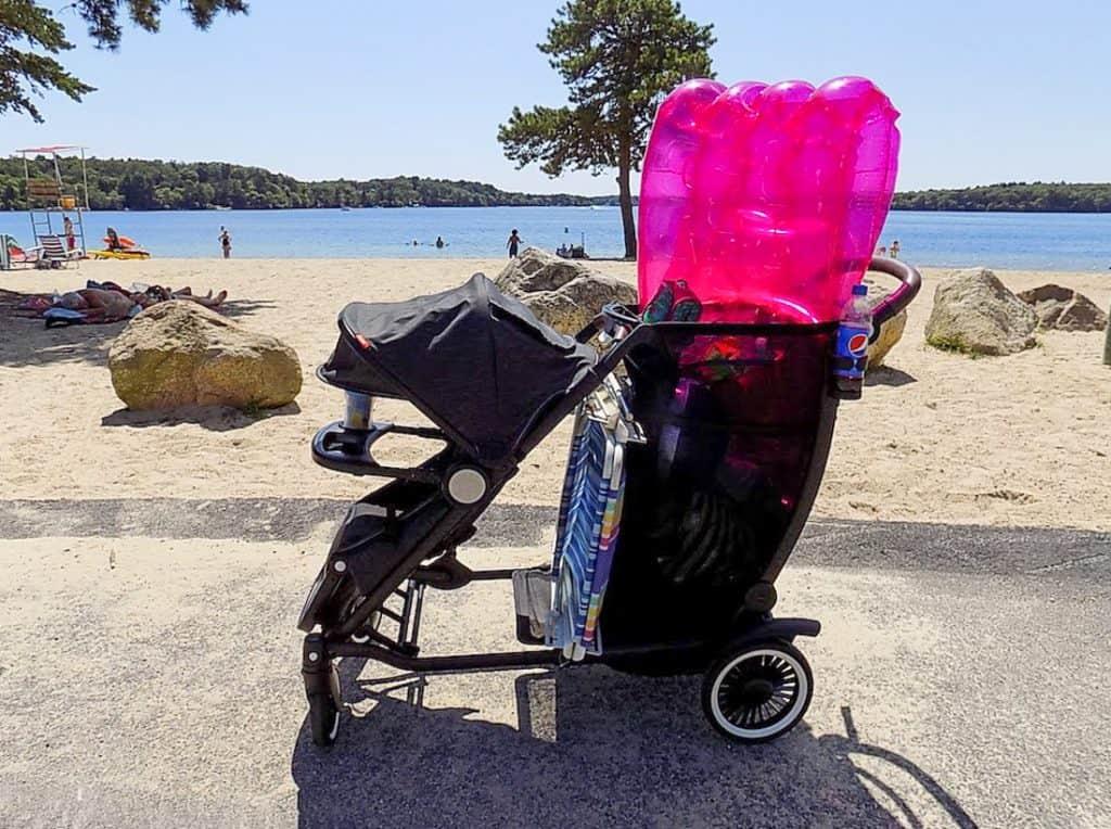 Stroller carries beach supplies to beach.