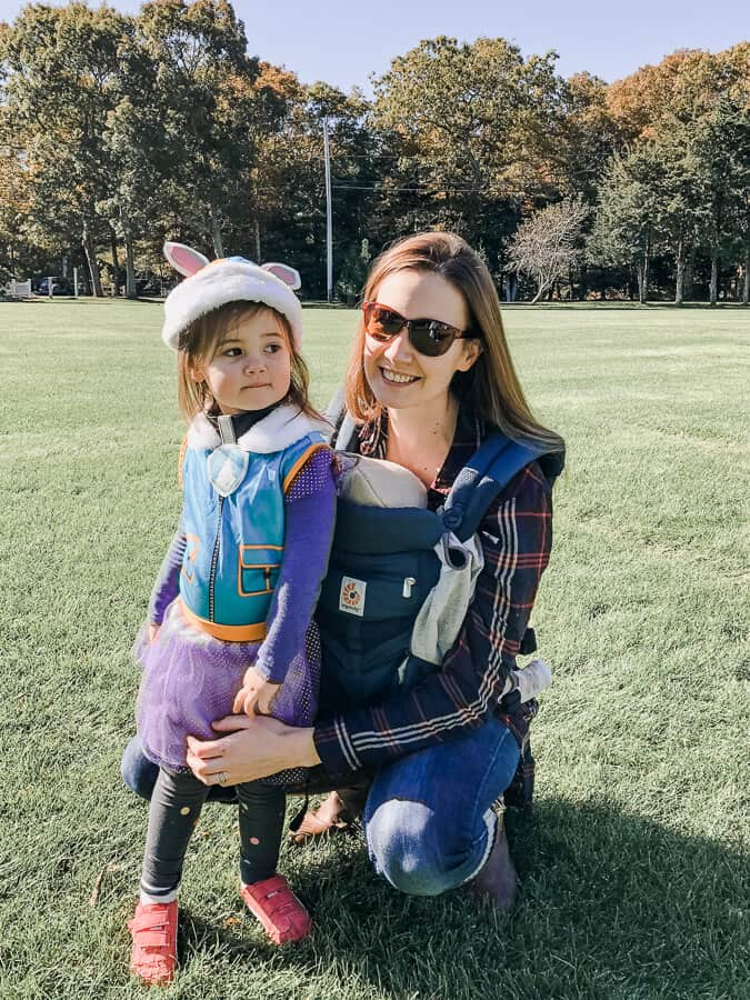 Mother wearing newborn in an Ergo Baby Omni 360 in Cool Air Mesh with her toddler